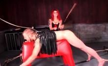 Redhead dominatrix torturing male sex slave