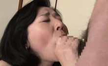 Kinky Japanese milf engages in passionate sex action with a young man