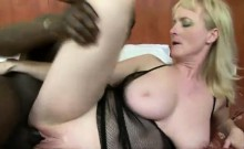 Monik is a busty granny who takes off her bra to let her