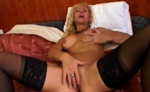 Gorgeous mature blondie spreads her hot legs to play alone