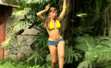 Feminine shemale is stripping yellow bikini and jerking off