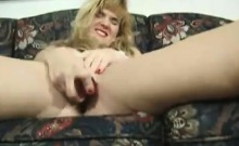 Orgasme having a large dildo that is red