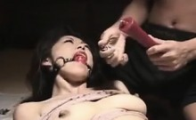 Kinky Oriental lady with big tits gets tied up and covered