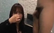 Asian Teen In Black Stockings Enjoys Giving A Blowjob