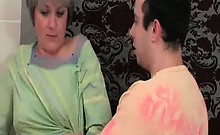Horny dude enters the bathroom where her mature whore is