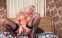 Blonde Mature masturbates with purple dildo