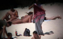 Hidden cam is set up at a nude beach catching some naked ba