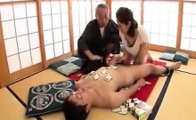 Old Asian dude watches as a new wife gives his son a blowjo