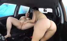 Busty woman Harmony Reigns eats examiner's twat in the car