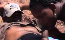 Black chick blowing cock outdoors
