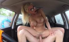 Couple banging in fake driving school car