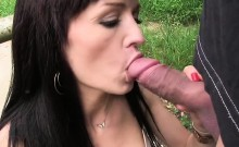 Busty redhead amateur sucks and fucks in woods